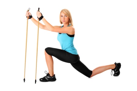 walking stick: A picture of a young woman practising nordic walking over white background Stock Photo