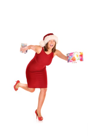 A picture of a pretty woman in Santas costume running with presents over white background photo