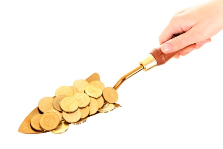 golden shovel: A picture of a small shovel full of golden coins over white background Stock Photo