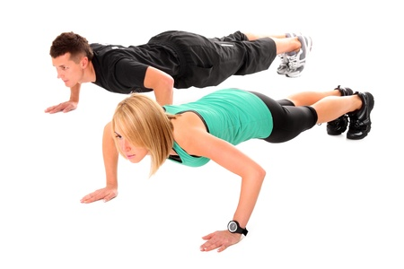 A picture of a young couple working out over white background Stock Photo