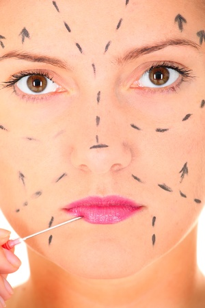 botox: A close-up of female face and a needle against white background