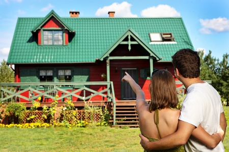 A picture of a young couple outside their new country house Stock Photo - 11348613