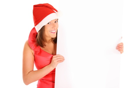 A picture of a woman Santa holding a white board and smiling over white background photo