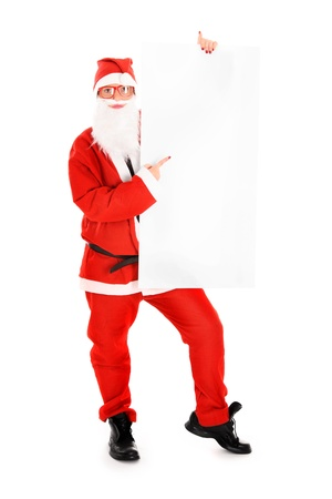 A picture of a woman Santa holding a white board and pointing at it over white background photo
