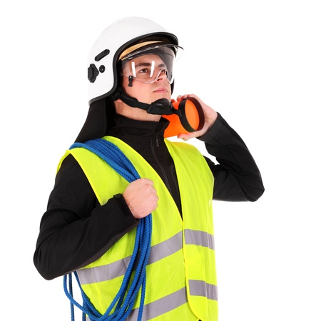 emergency vest: A picture of a young firefighter in a white helmet looking against white background