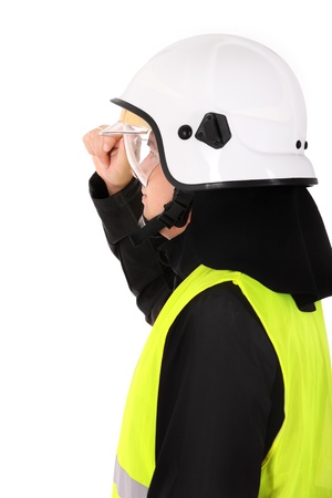 A picture of a young firefighter in a white helmet looking against white background photo