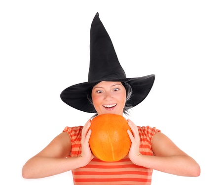 A picture of a young woman with a pumpkin smiling over white backgrund photo