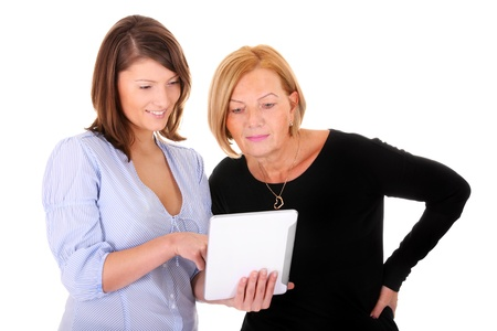 A picture of a mother and daughter working together on a tablet over white background photo