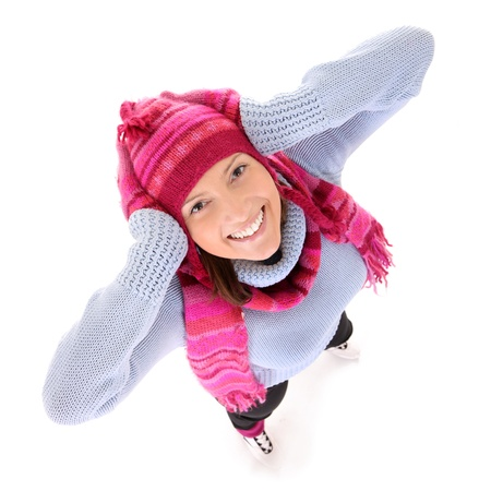 A picture of a young happy woman skating over white background photo