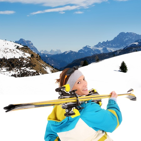 A picture of a young female skier enjoying snow in the Alpes photo