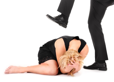 dominance: A picture of a male leg treading on a female employee over white background