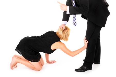 begging: A picture of a man dismissing female employees over white background Stock Photo