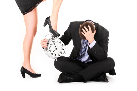 dominance: A picture of a sexy woman showing a deadline to her employee over white background Stock Photo