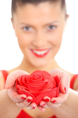 A blurry portrait of a young beautiful woman giving a red rose and smiling photo