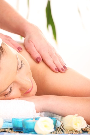 A picture of a young beautiful woman having massage in a spa center photo