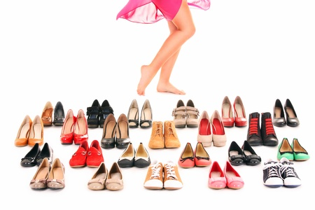 A picture of sexy female legs among shoes over white background Stock Photo - 12612312