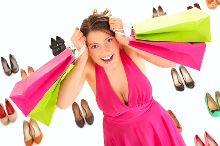 A picture of a pretty young woman shopping for shoes over white background photo
