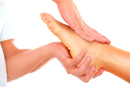 therapeutic massage: A picture of a physio therapist giving a foot massage over white background