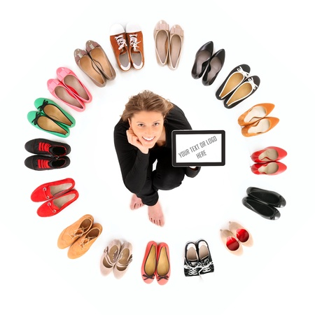 A picture of a pretty young woman sitting in the circle of shoes over white background Stock Photo - 12612663
