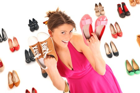A picture of a pretty young woman shopping for shoes over white background Stock Photo - 12678294