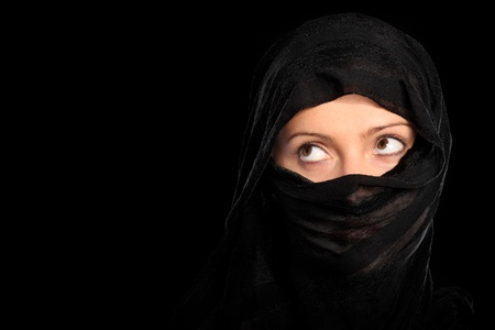 veils: A picture of a young muslim girl over black background Stock Photo