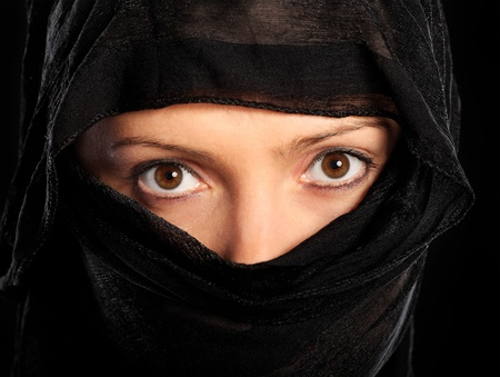 burqa: A picture of a young muslim woman over black background