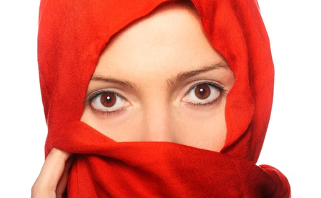 A picture of a young muslim woman in a red scarf over white background photo