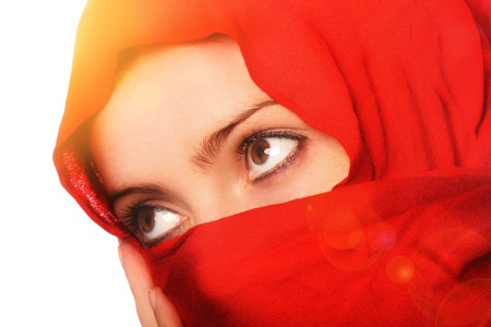 burqa: A portrait of a beautiful arabic girl looking at the sun