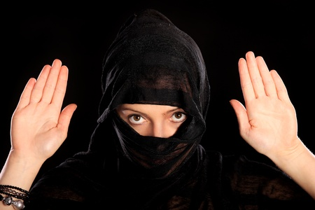 burka: A picture of a young arabic woman surrending over black background