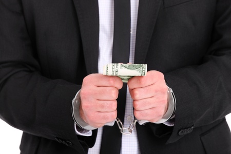 A picture of a businessman in handcuffs holding dollars Stock Photo - 12911271