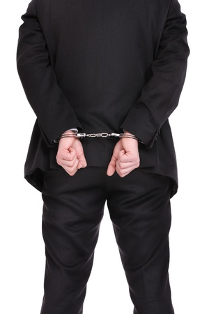 suit  cuff: A picture of a businessman in handcuffs standing over white background
