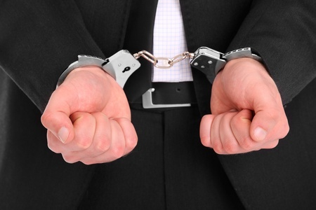 A picture of a businessman in handcuffs  photo