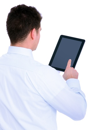tablet pc in hand: A picture of a young businessman with his tablet computer over white background Stock Photo