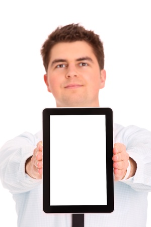 A picture of a young businessman with his tablet computer over white background photo