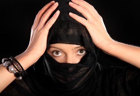 A picture of a young muslim girl over black background photo
