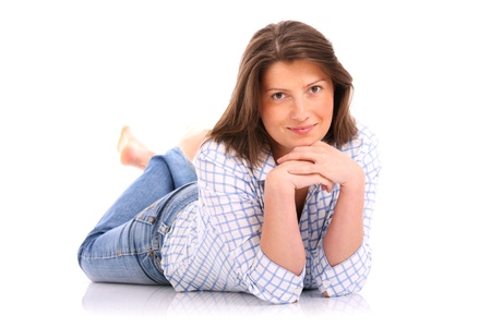 A picture of a young woman lying on the floor and smiling over white background Stock Photo - 13042032