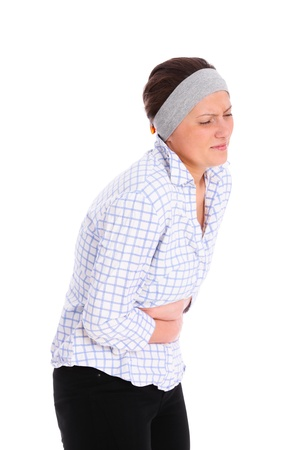 stomachache woman: A picture of a young woman suffering from stomach ache over white background Stock Photo