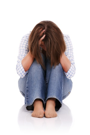 A picture of a frustrated woman covering her face over white background Stock Photo - 13069409