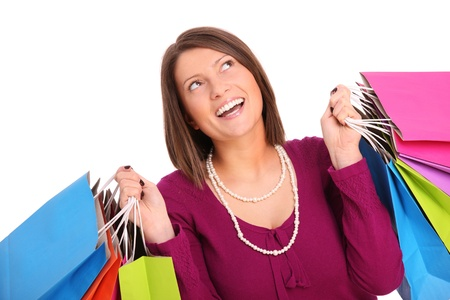 A picture of a young happy woman with shopping bags over white background Stock Photo - 13133810