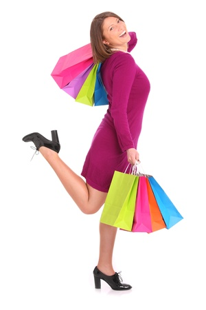 A picture of a young happy woman with shopping bags over white background Stock Photo - 13133786