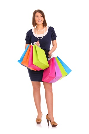 A picture of a young happy woman with shopping bags over white background Stock Photo - 13133795