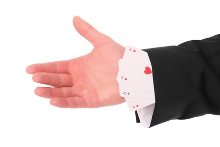 trickster: A picture of a male hand having three aces up the sleeve Stock Photo