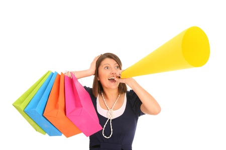 A picture of a young happy woman with a megaphone announcing your product over white background Stock Photo - 13133799