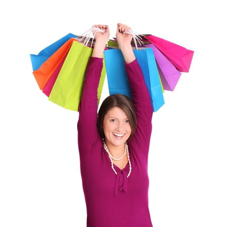 A picture of a young happy woman with shopping bags over white background Stock Photo - 13325169