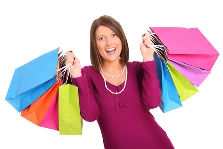 A picture of a young happy woman with shopping bags over white background Stock Photo - 13325139