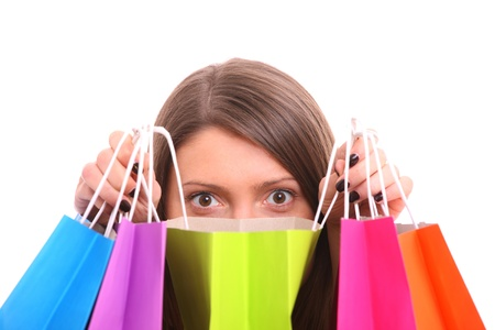 A picture of a young happy woman among shopping bags over white background Stock Photo - 13325131