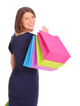 A picture of a young happy woman among shopping bags over white background Stock Photo - 13325132