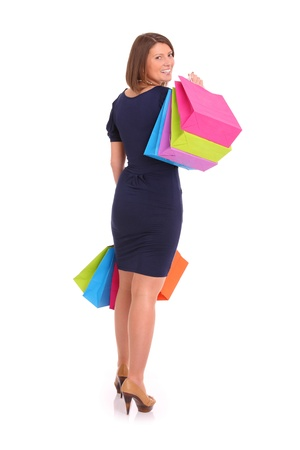 A picture of a young happy woman with shopping bags over white background Stock Photo - 13325119