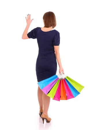 A picture of a young woman with shopping bags waving goodbye over white background Stock Photo - 13325120