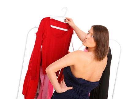 decission: A picture of a young woman trying to pick clothes Stock Photo